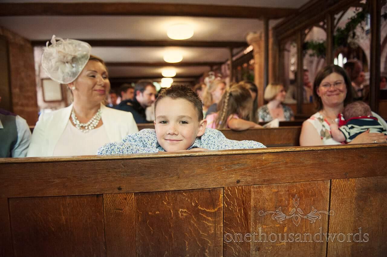 child wedding guest portrait at church wedding service