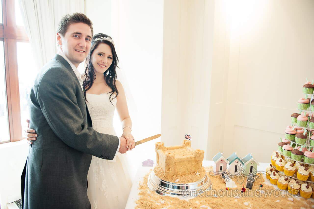 Cutting the cake at Poole Hotel wedding