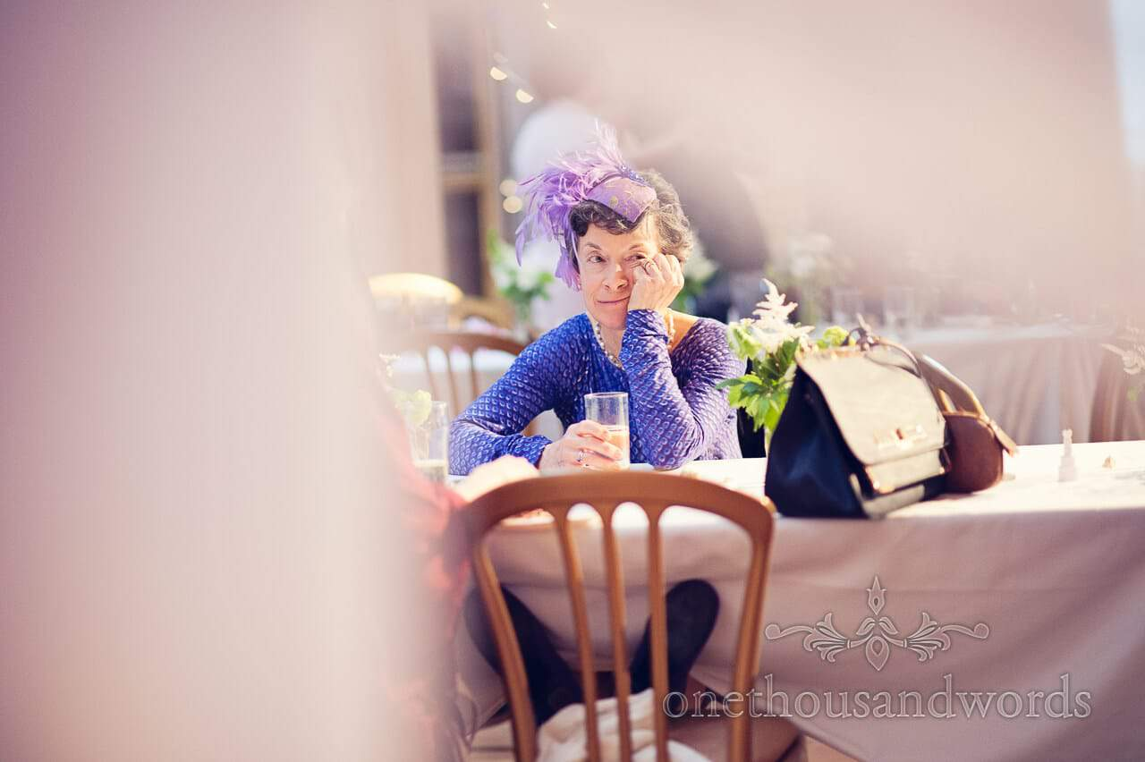 Documentary wedding photograph of tired wedding guest