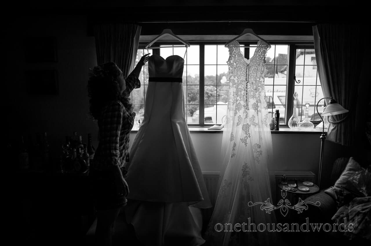 Documentary wedding photography of Bride reaching for two piece wedding dress