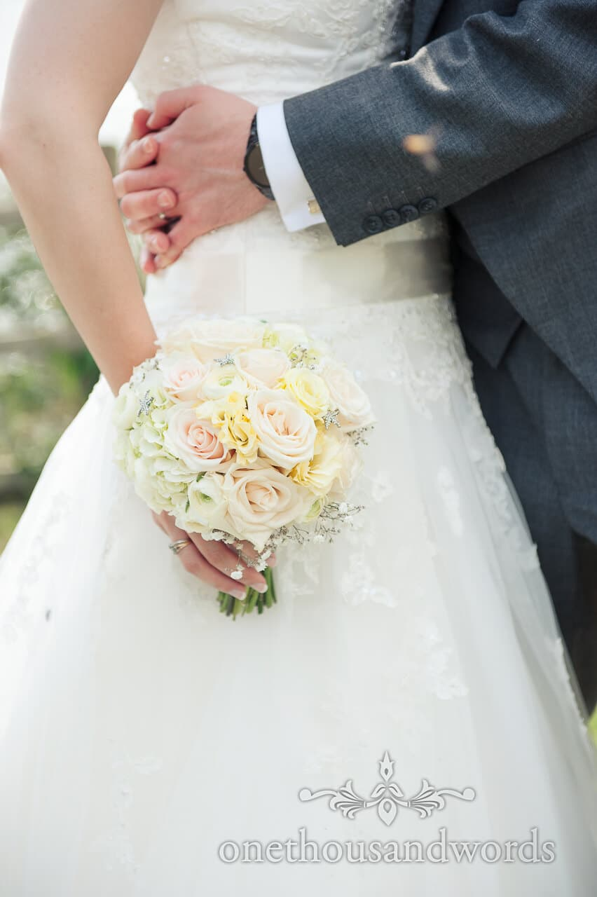 Yellow, dusty pink and white weddign flower bouquet photograph