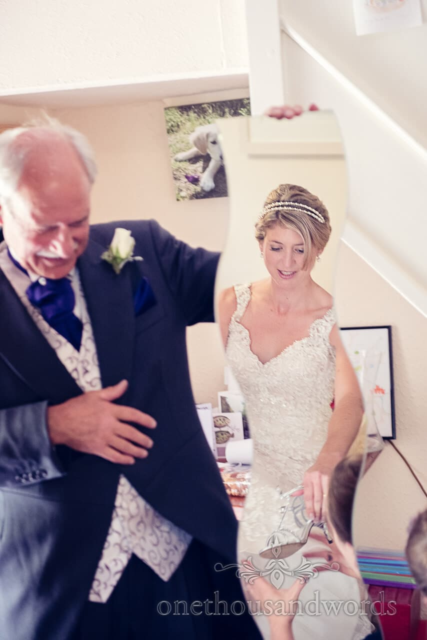 Father holds mirror for bride portrait photograph