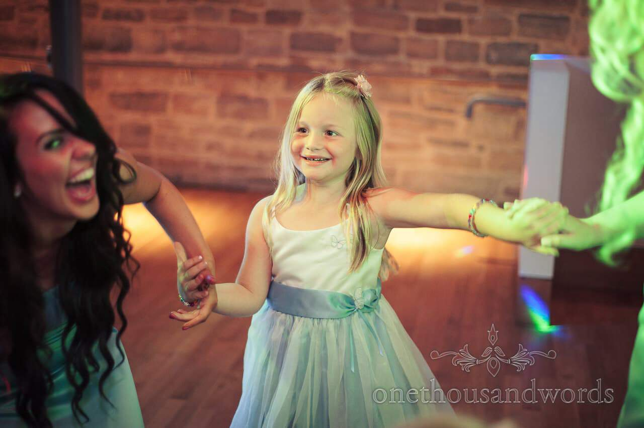 Flowergirl dancing at Durlston Castle wedding