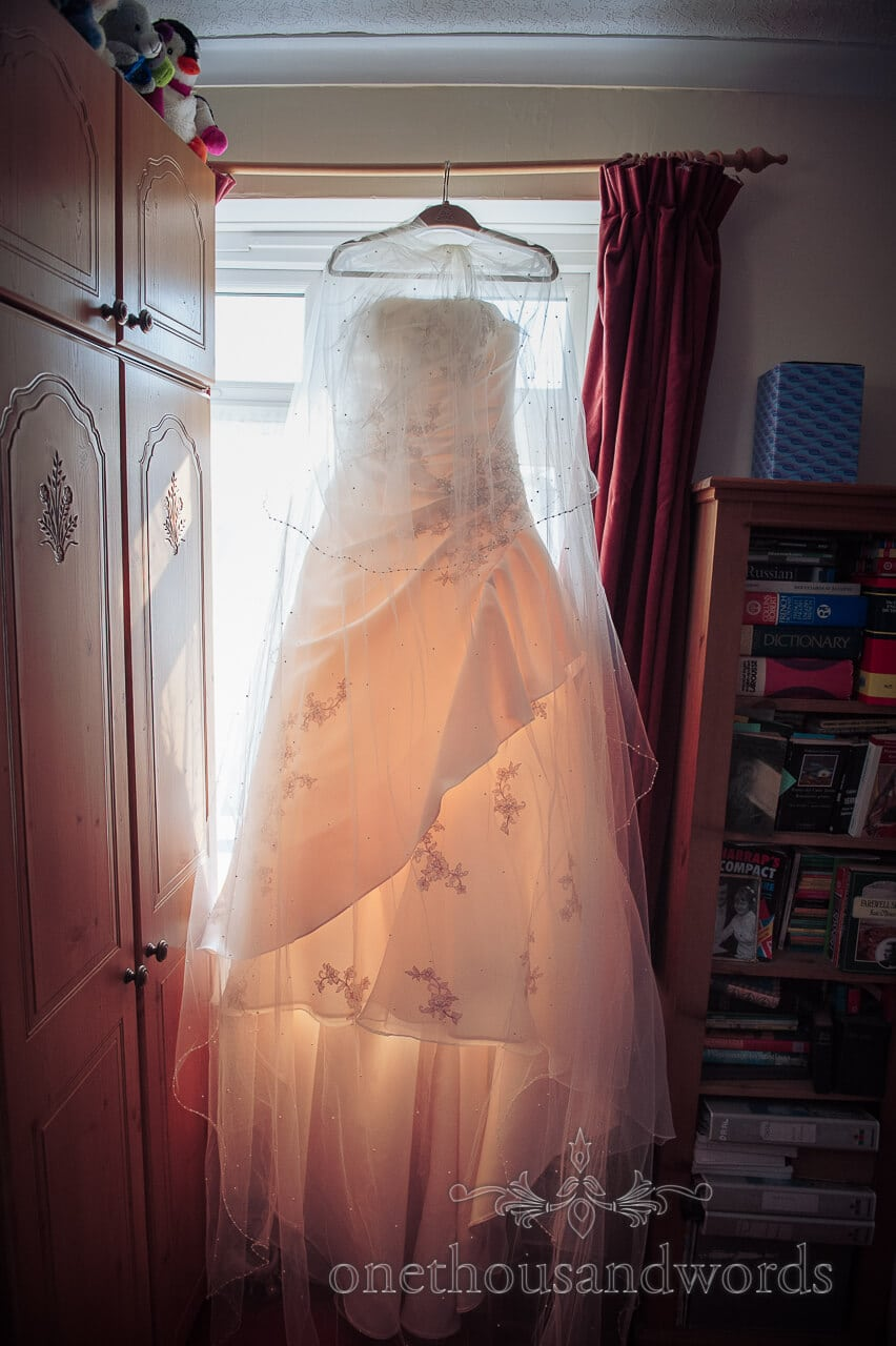 Glowing A line wedding dress in window with soft toys