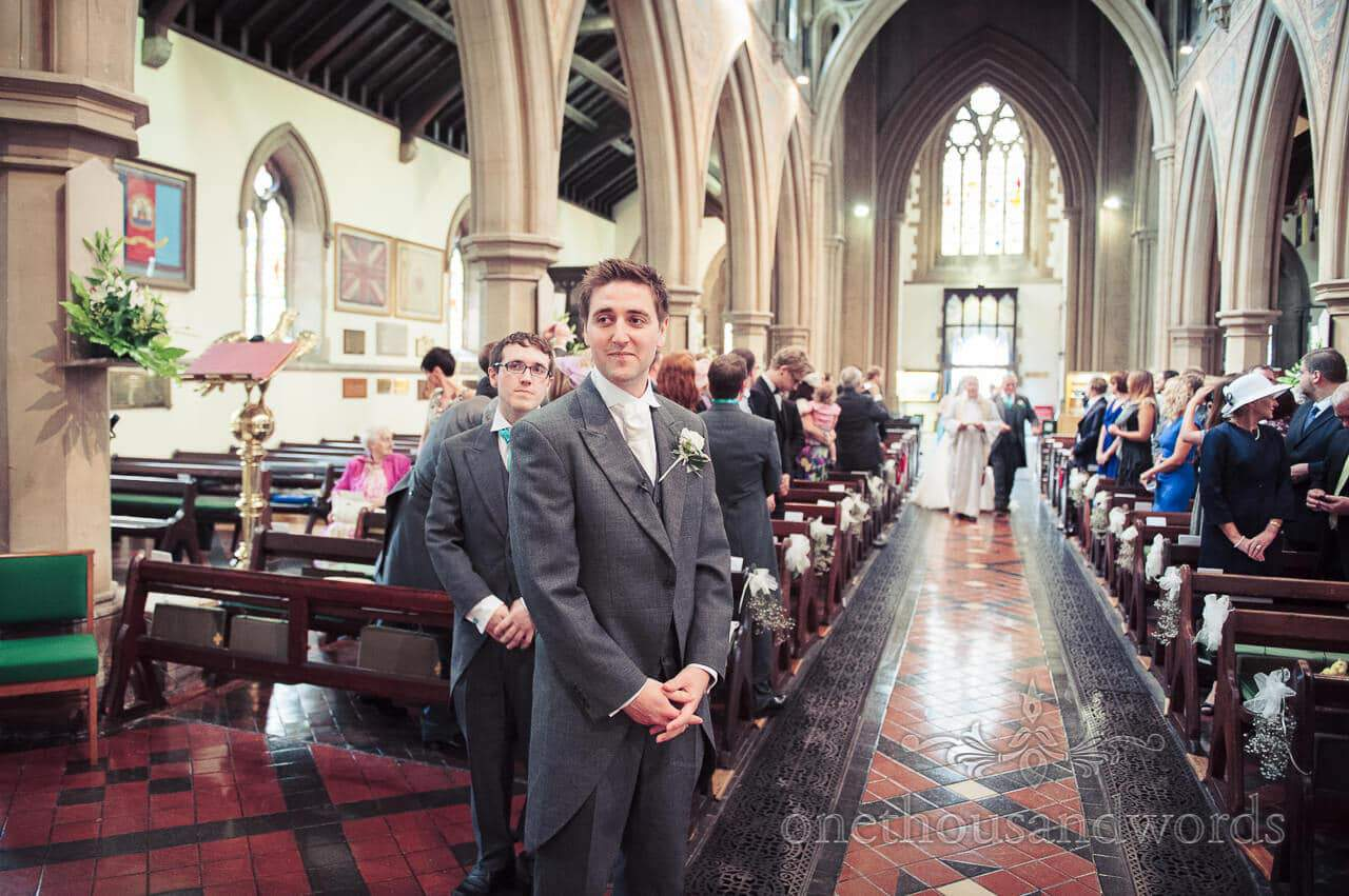 Groom awaits his bride at St Peters Church in Bournemouth