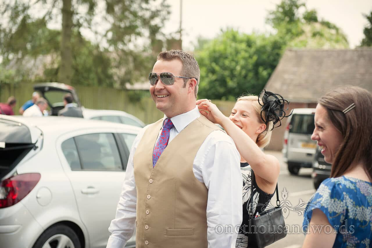 Groomsman in reflective shades at military wedding
