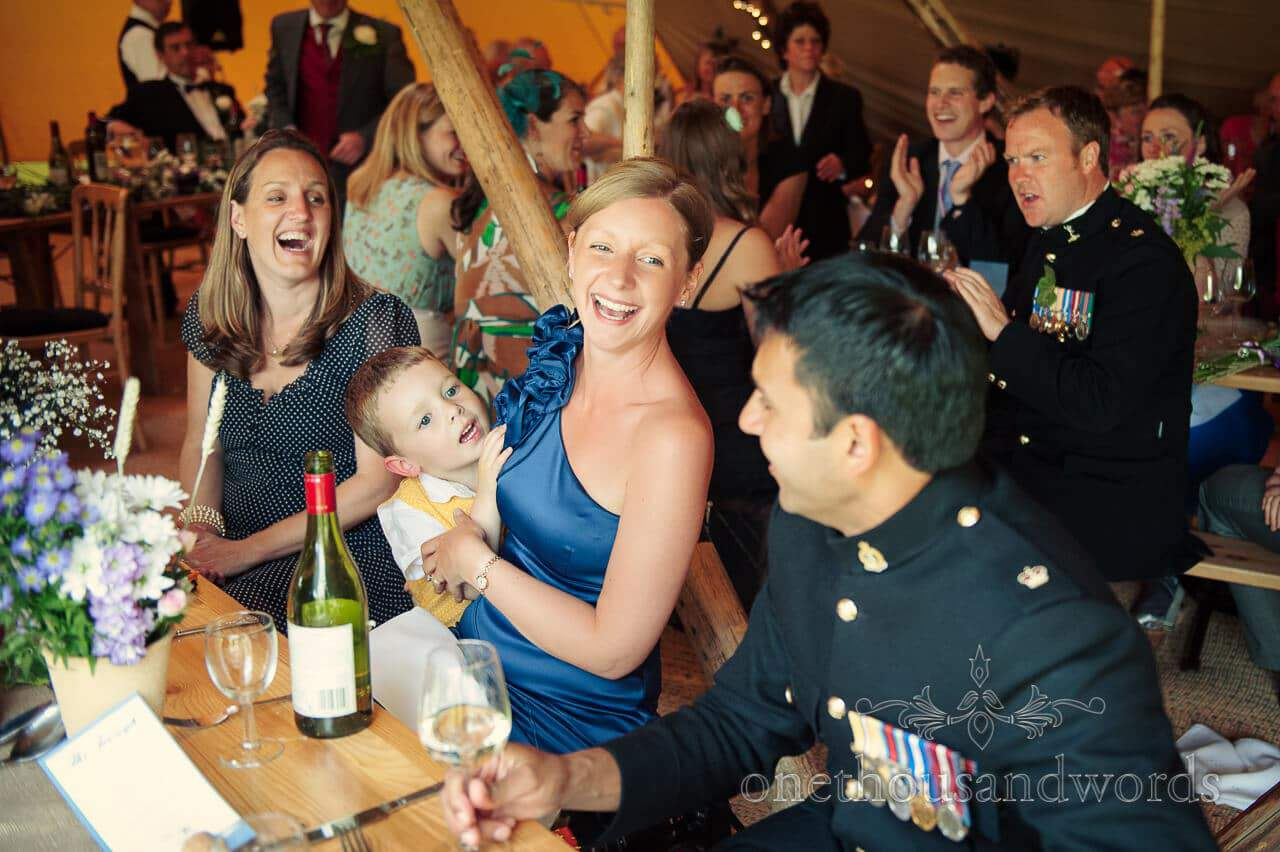 military wedding photographs of wedding guests in wedding tipi