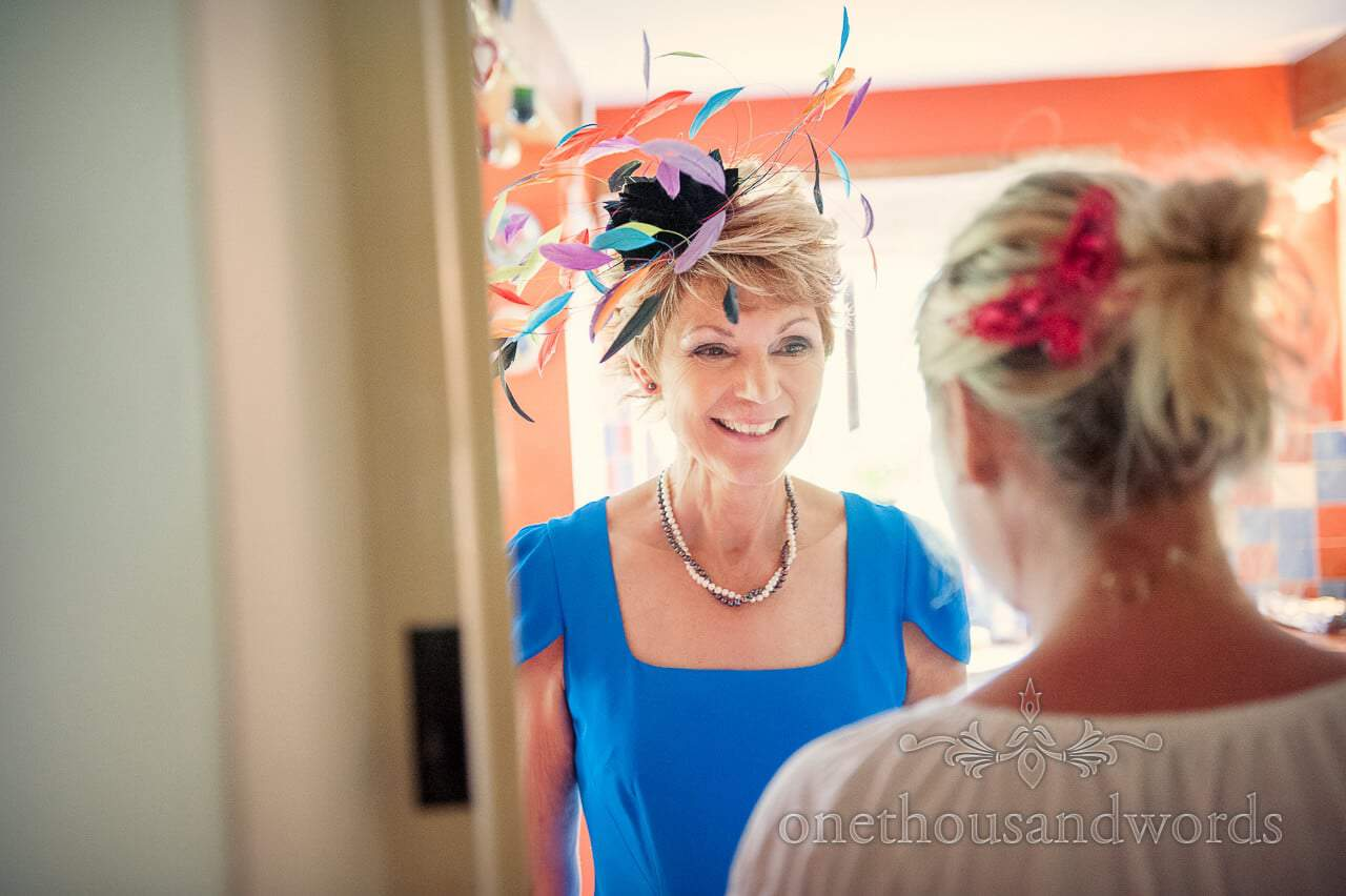 Mother of the bride with multi colour feathered fascinator