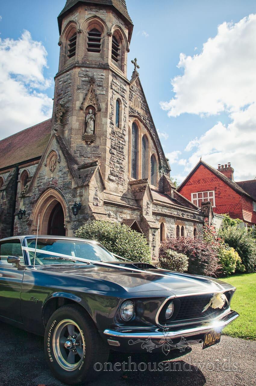 Mustand wedding car outside church in Lyndhurst