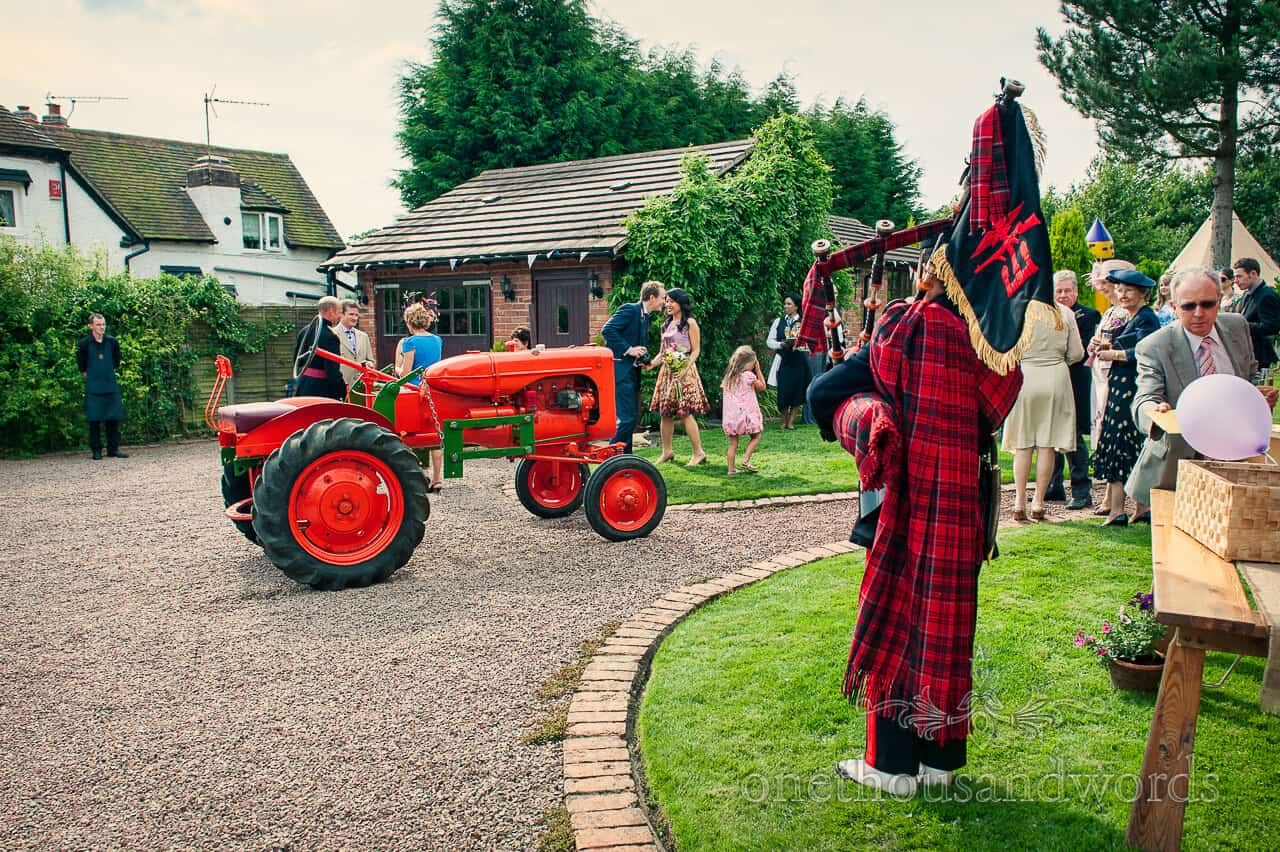Orange wedding tractor and bag piper from military wedding photographs