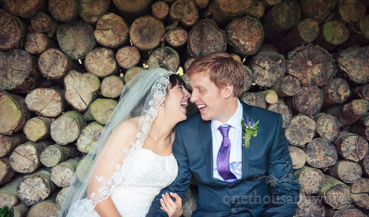 weddings in the wood photographs of bride and groom with woodpile