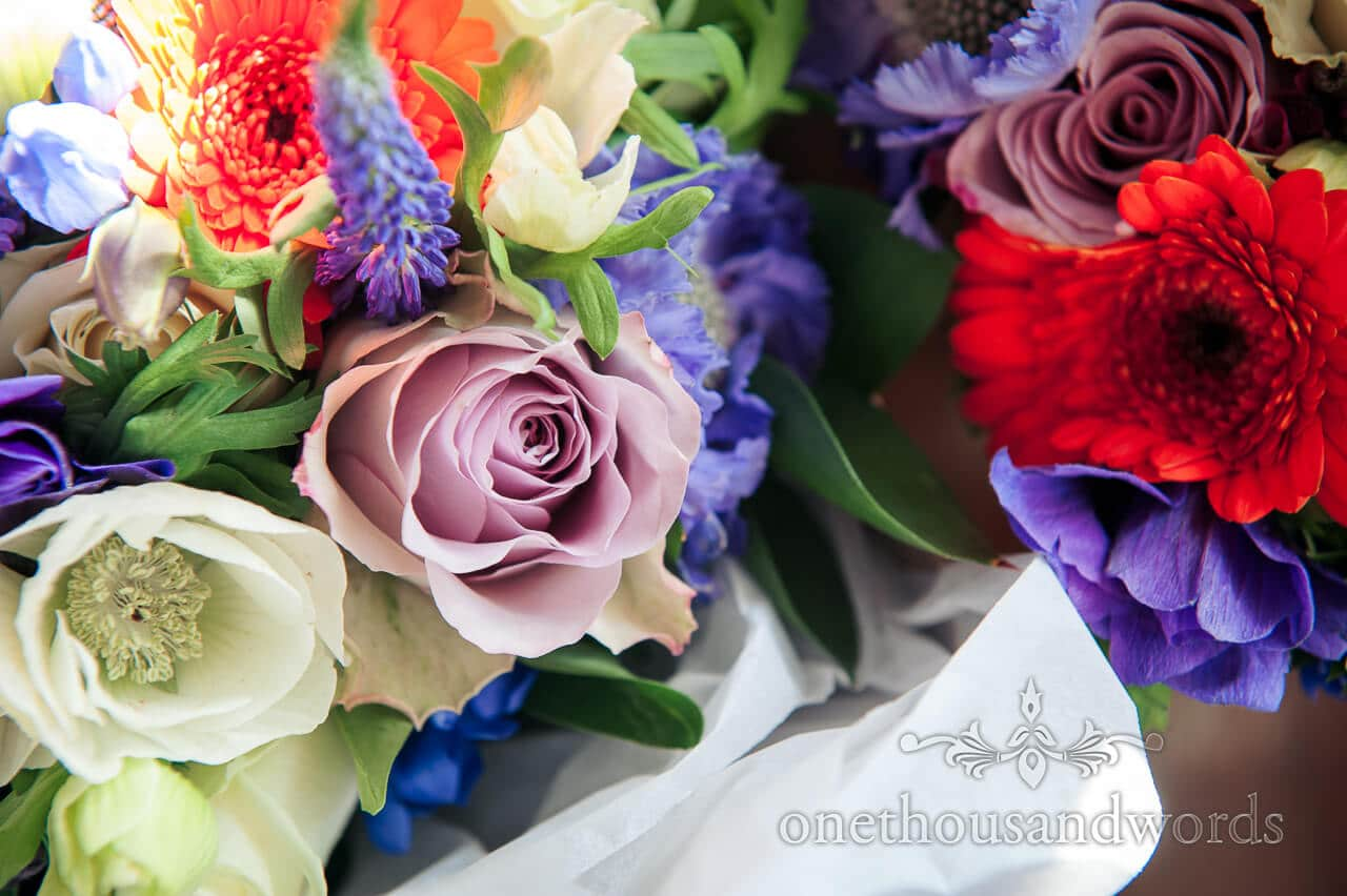 Purple, red and blue wedding flowers