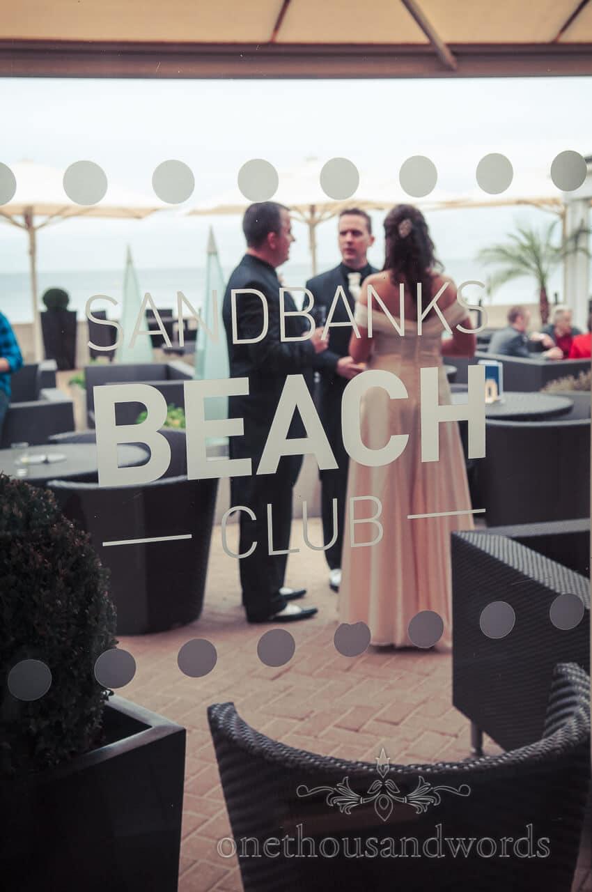 Sandbanks Beach Club sign at a Sandbanks Beach wedding