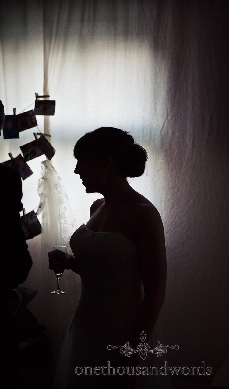 Silouette of bride in Carpenters Barn, Weddings in the wood