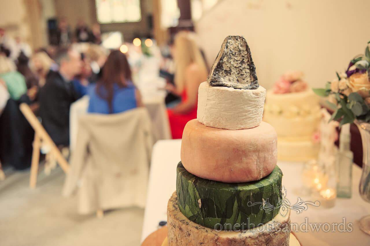 Tower of cheeses at Plush Manor wedding in Dorset