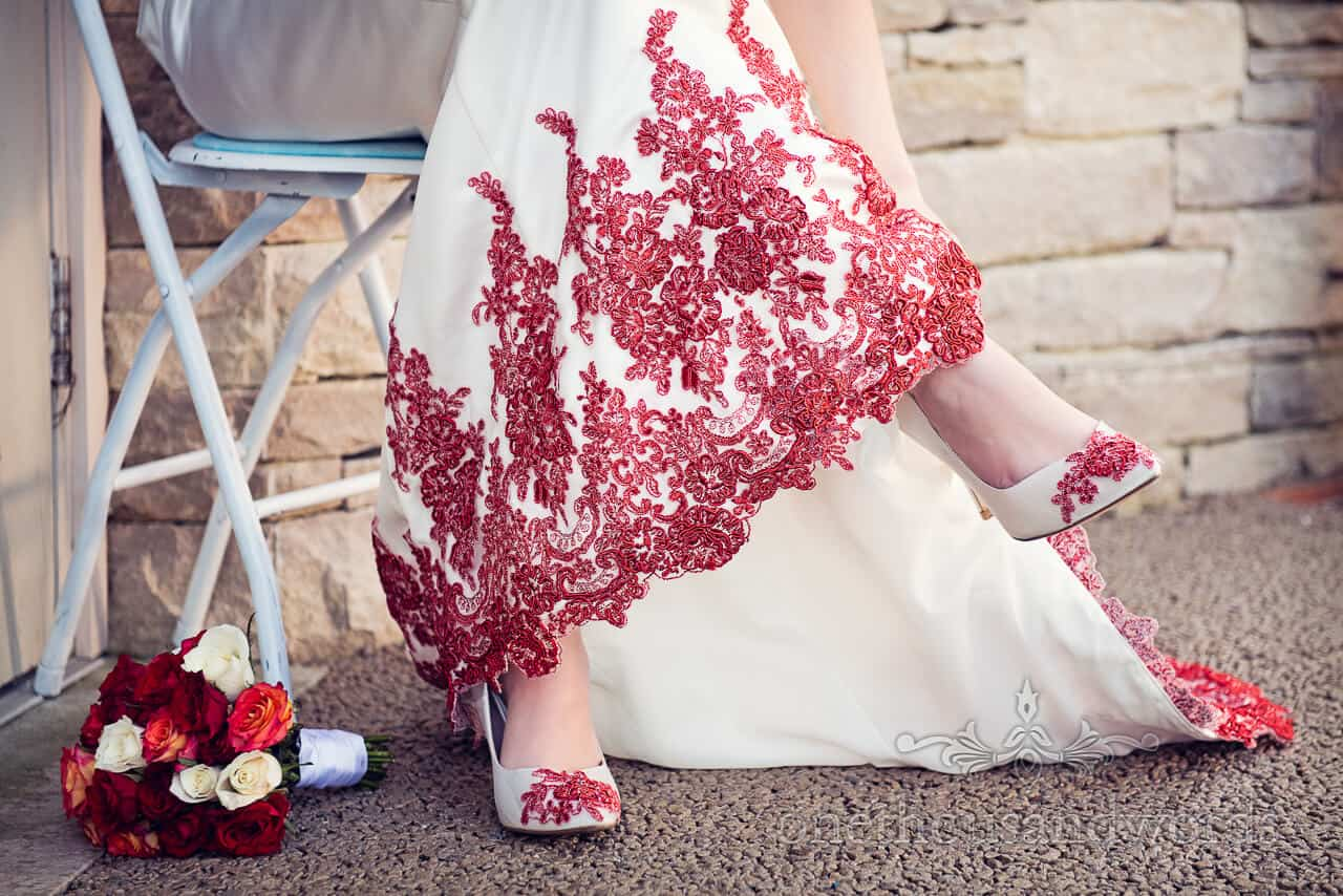 Wedding Dress and matching shoes red detail photograph
