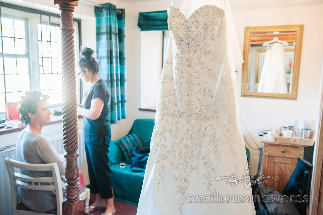 Wedding dress hangs at Bankes Arms Hotel, Corfe Castle Wedding