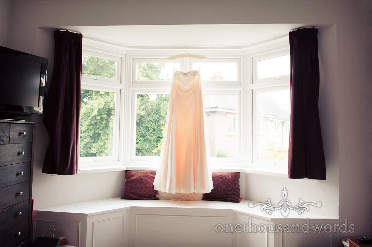 Wedding dress in window for Sandbanks beach wedding