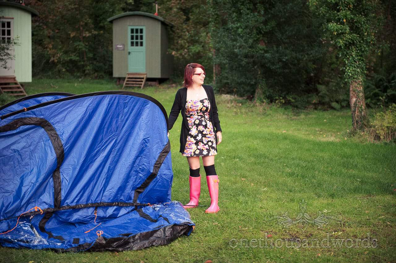 Wedding guest erects tent for wedding camping at weddings in the wood