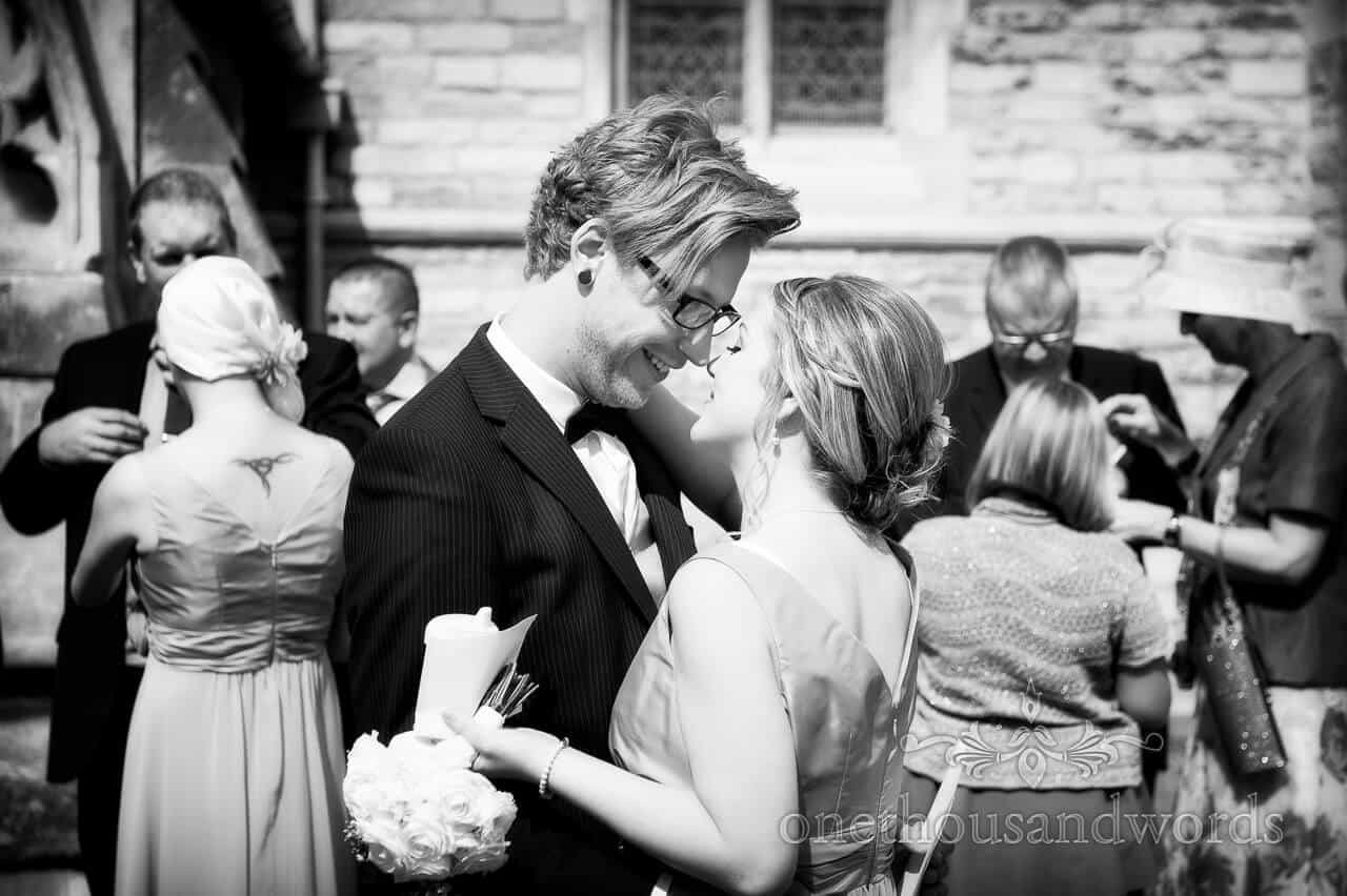 Black adn white photograph of wedding guests embracing
