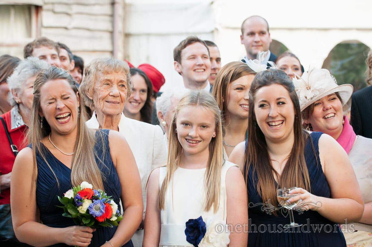 wedding guests laughing during group photographs