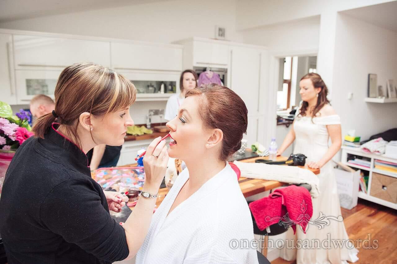 Wedding makeup artist on wedding morning