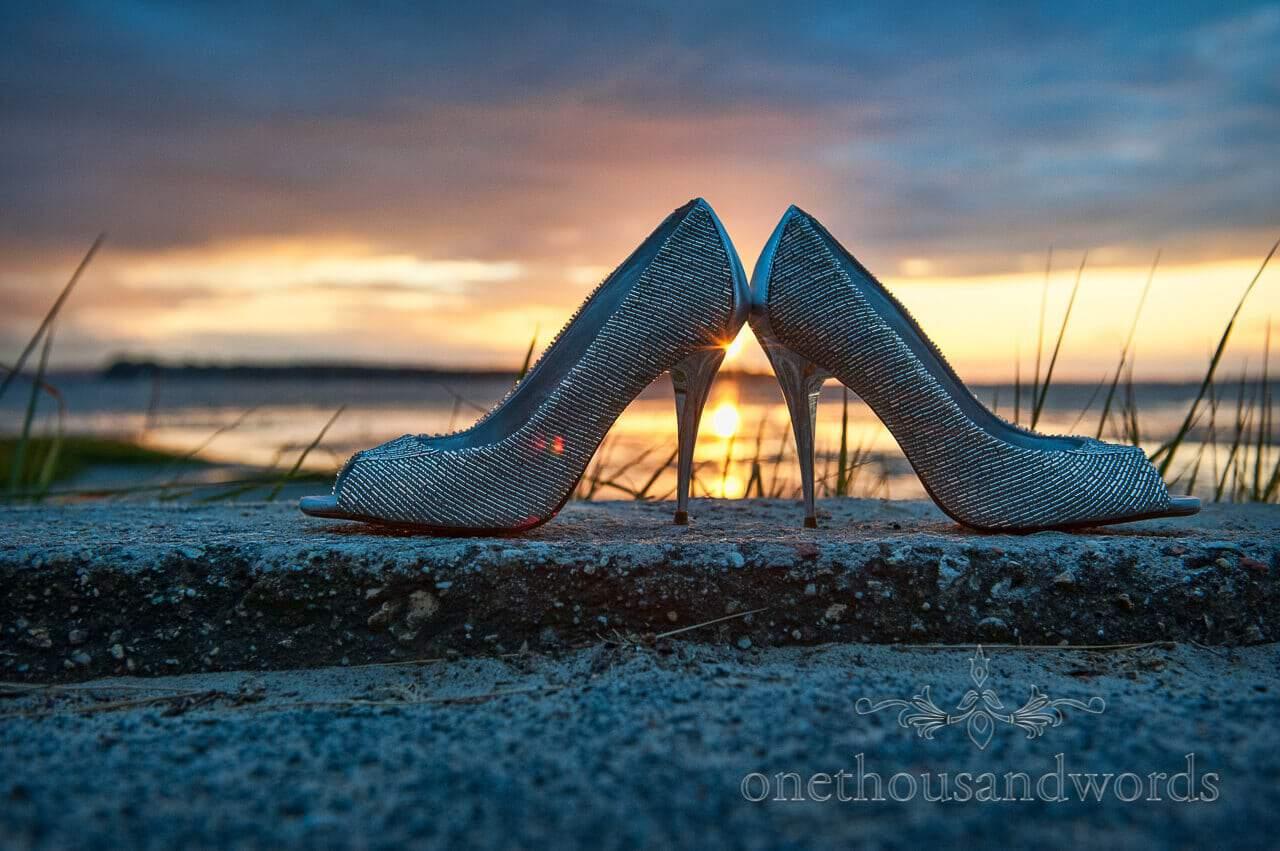 Wedding shoes with sunset at Sandbanks