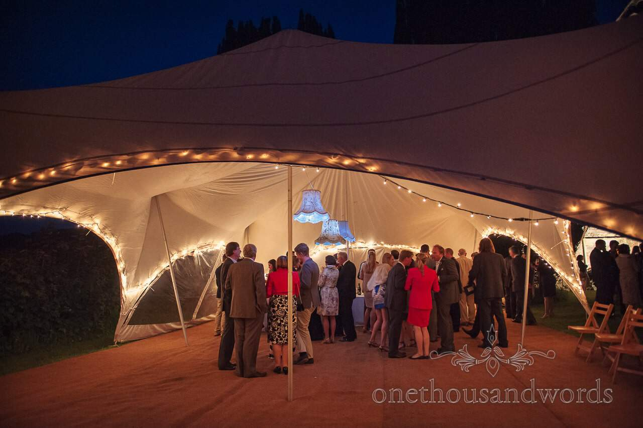 Wedding tent with lampshades at Plush Manor wedding evening