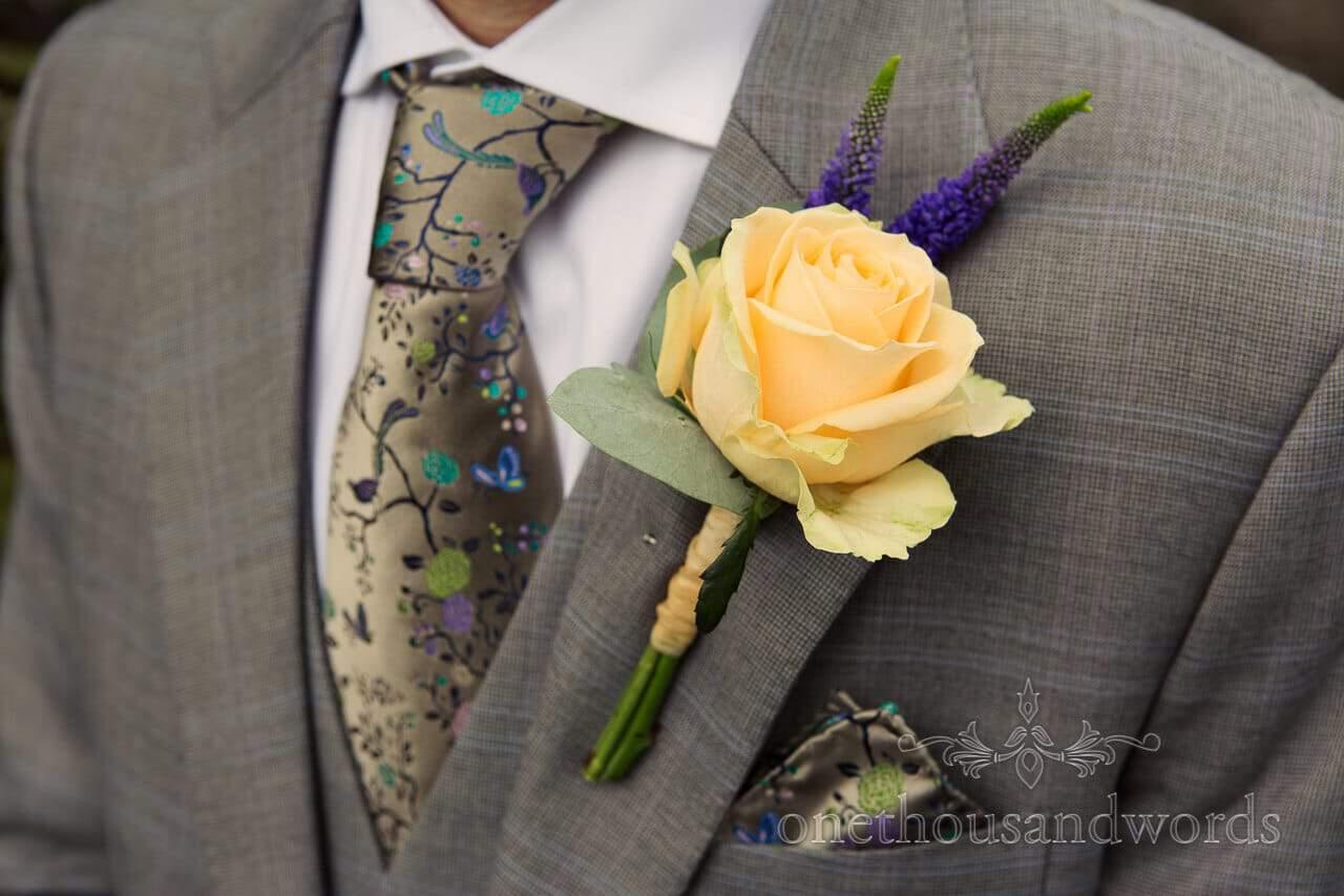 yellow rose button hole at Plush Manor Wedding