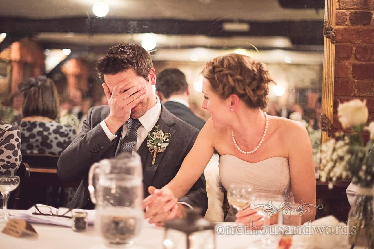 Best man's speech reaction photograph at Old Mill wedding in Aldermarston