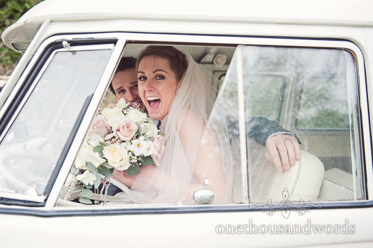 Bride and groom in VW capervan at Berkshire wedding venue