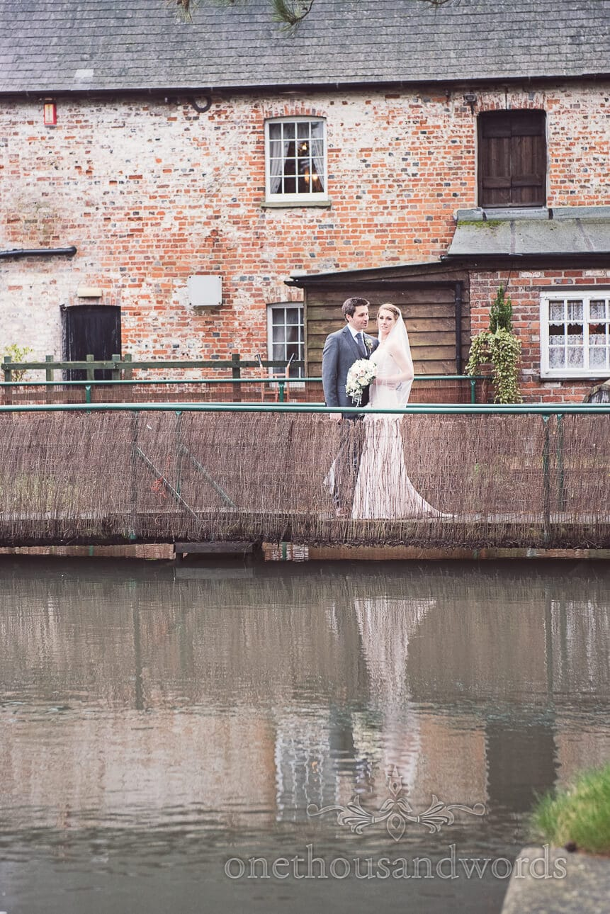 bride and groom old mill reflection berkshire wedding photography