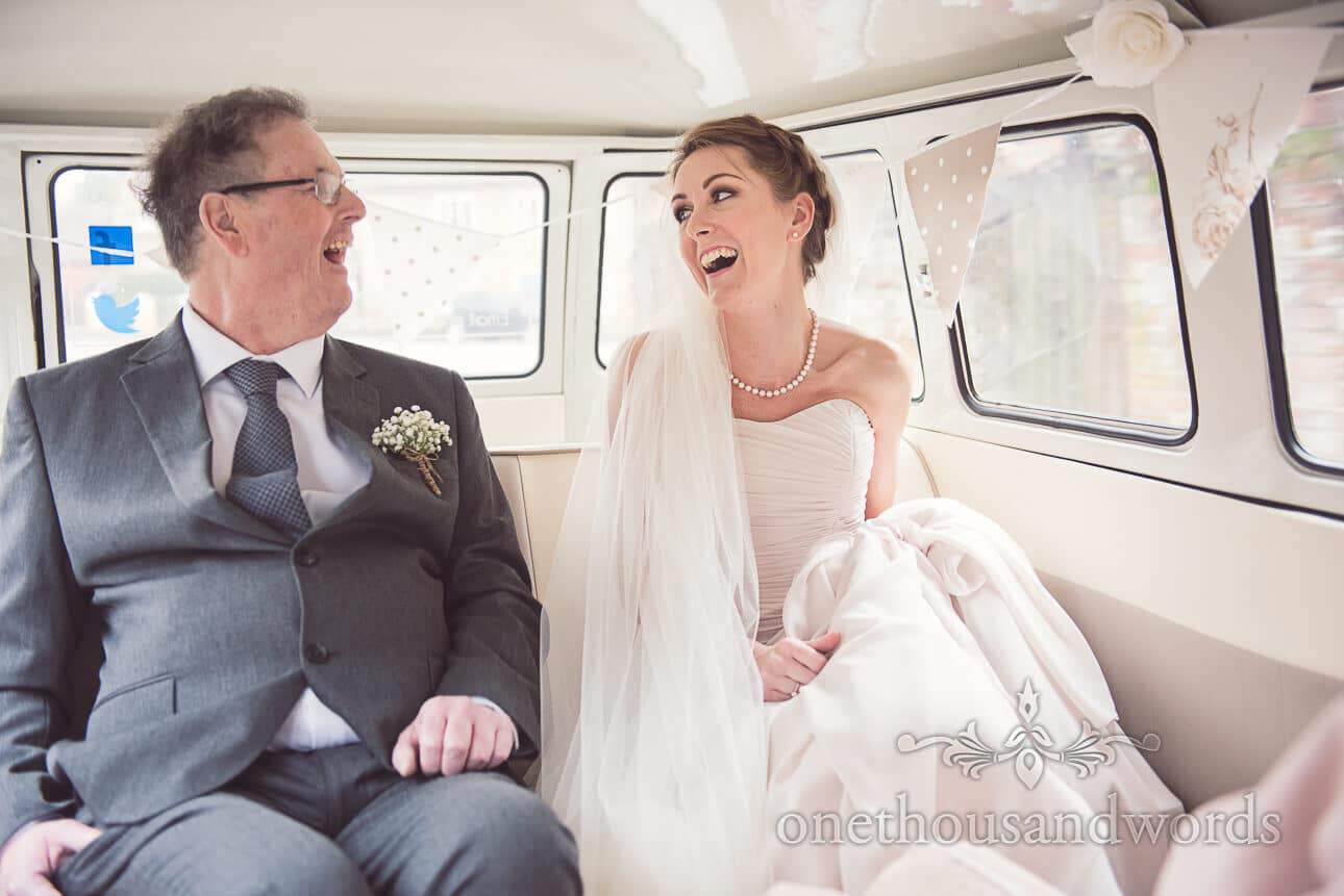 Bride and her father in VW Campervan on wedding morning
