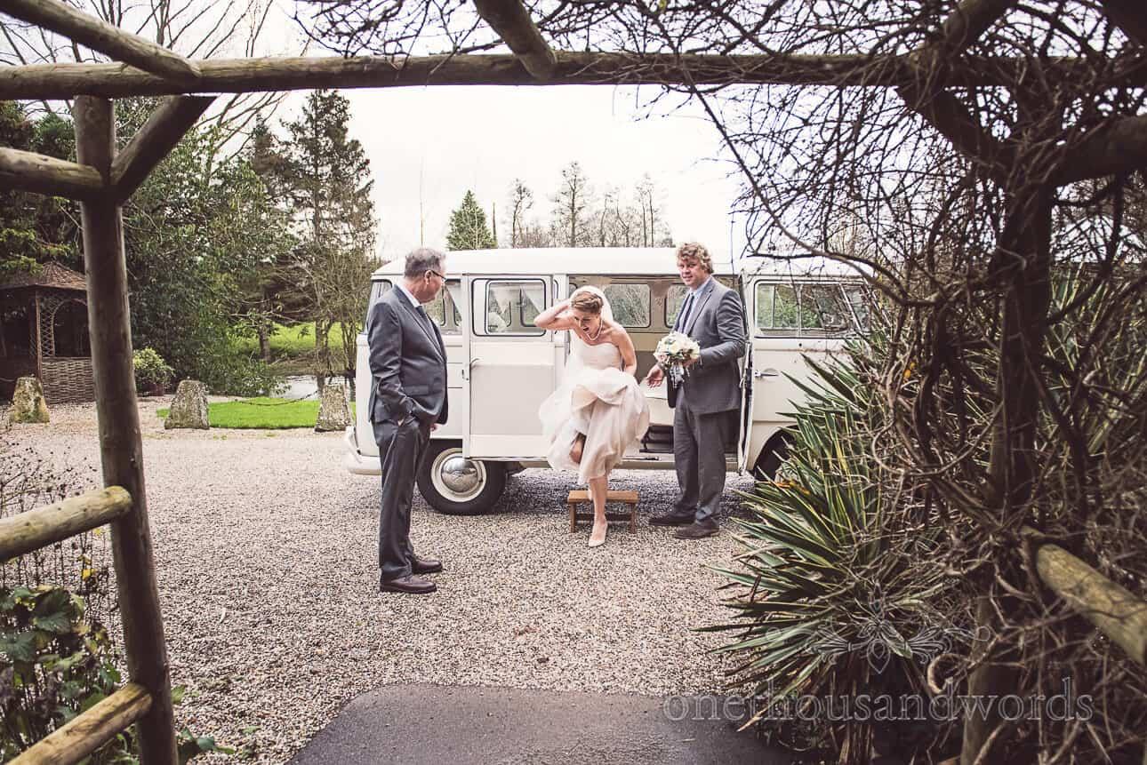 Bride arrives in VW splitscreen campervan at Old Mill in Aldermaston