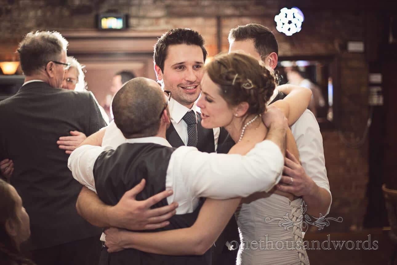 Bride, groom and best men dancing from Berkshire wedding photographs
