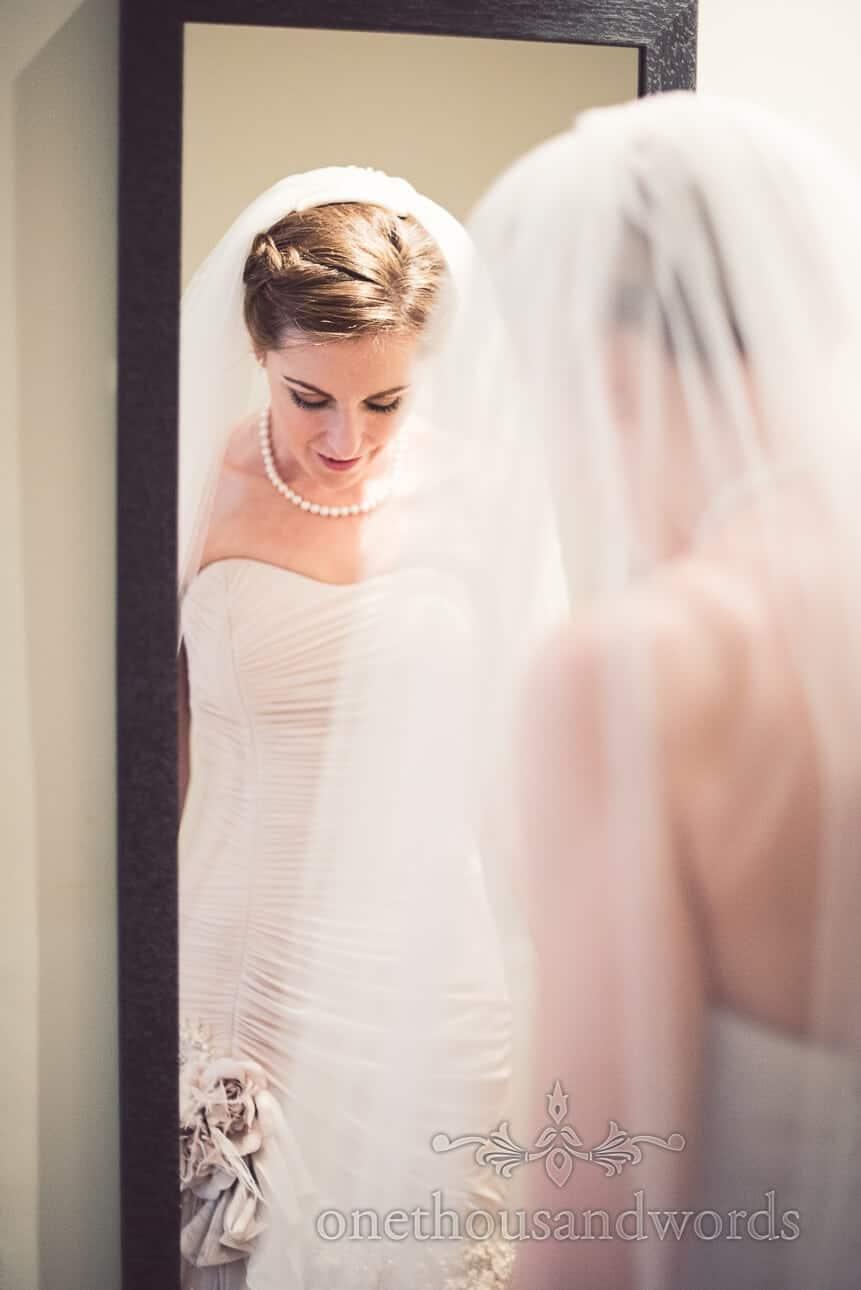 Bride in mirror on wedding morning Berkshire wedding photographs