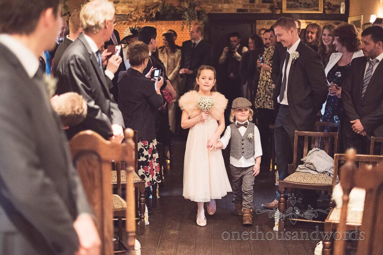 Flower girl and page boy enter wedding ceremony at Old Mill, Aldermarston