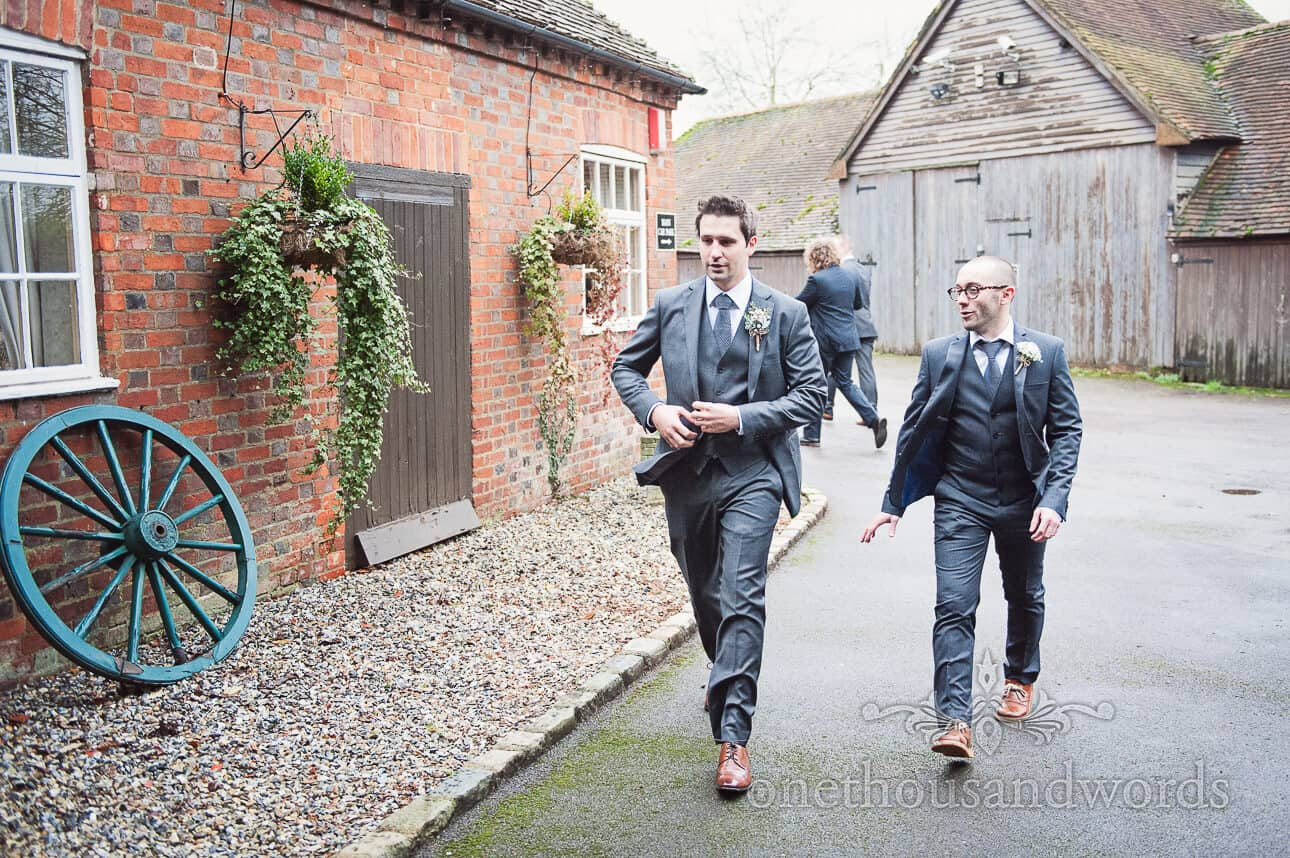 Groom and best man arriving at Old Mill wedding venue in Berkshire