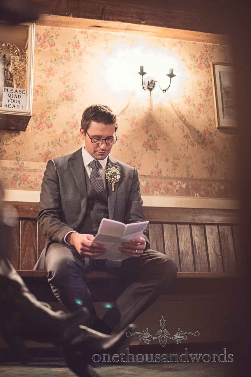 Groom practices his speech at the old mill wedding venue in Aldermarston