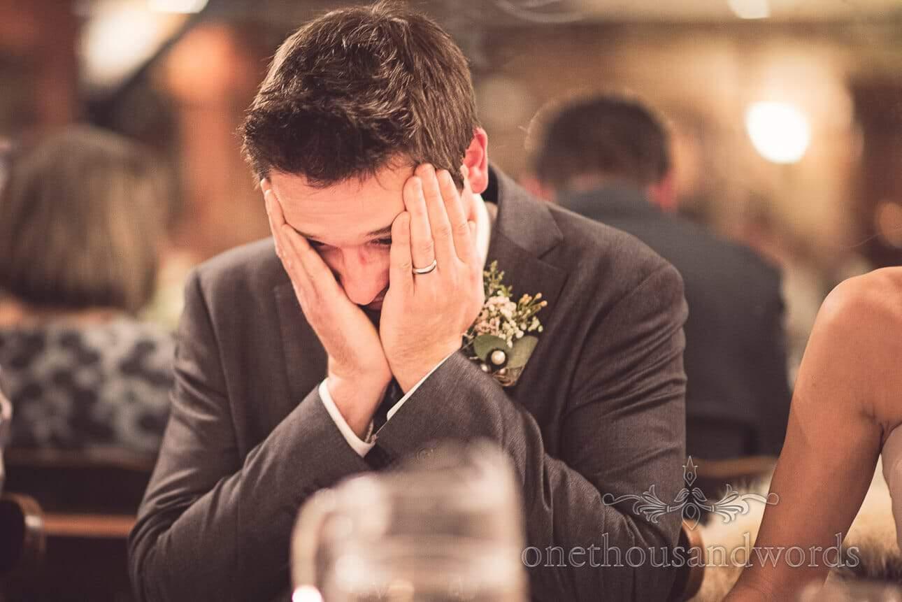 Groom reacting to embarrasign best men's speeches