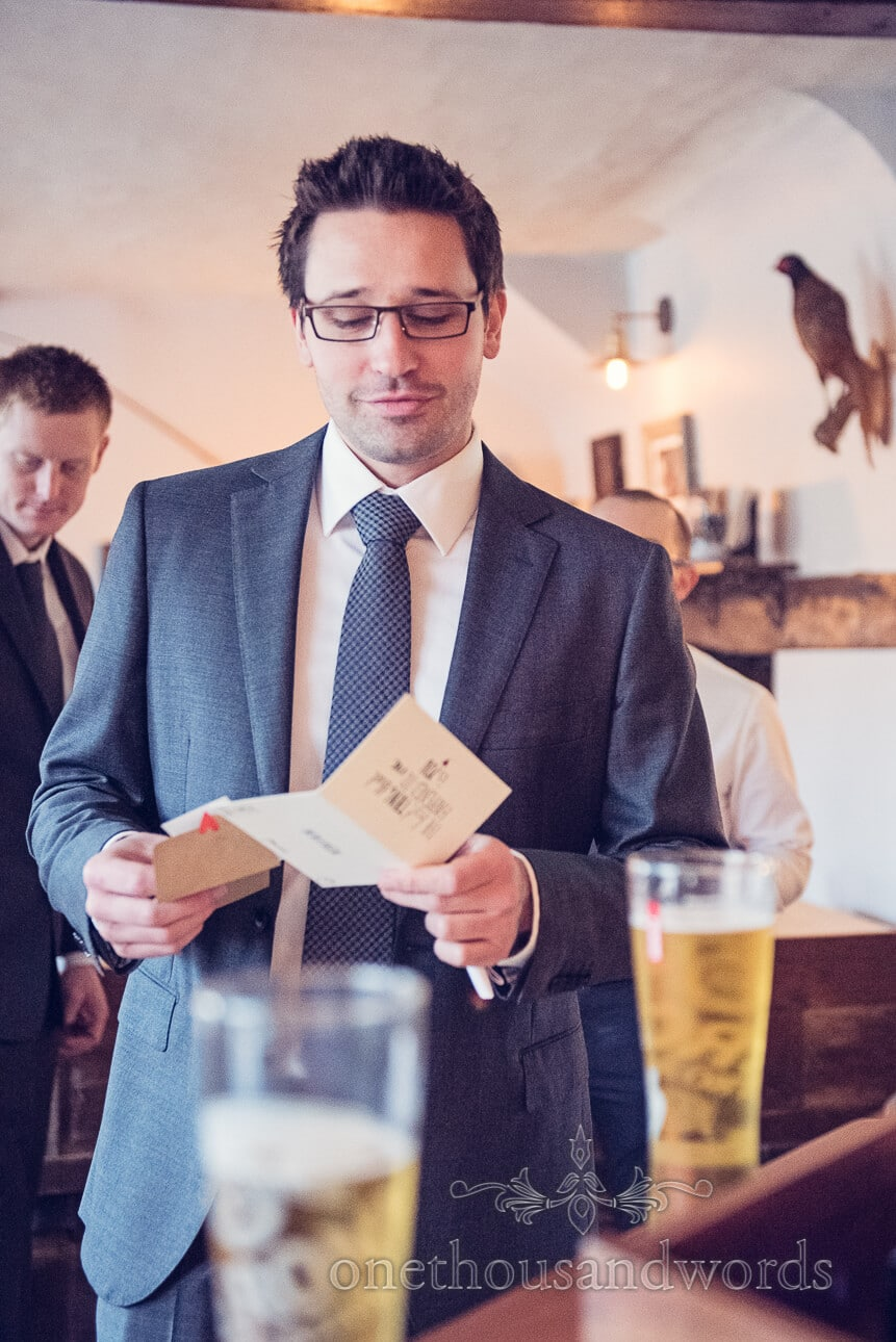 Groom reads letter from his bride on wedding morning