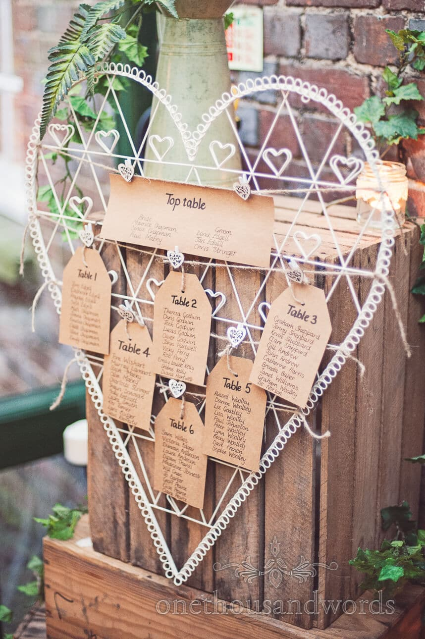 metal love heart and paper label wedding table plan