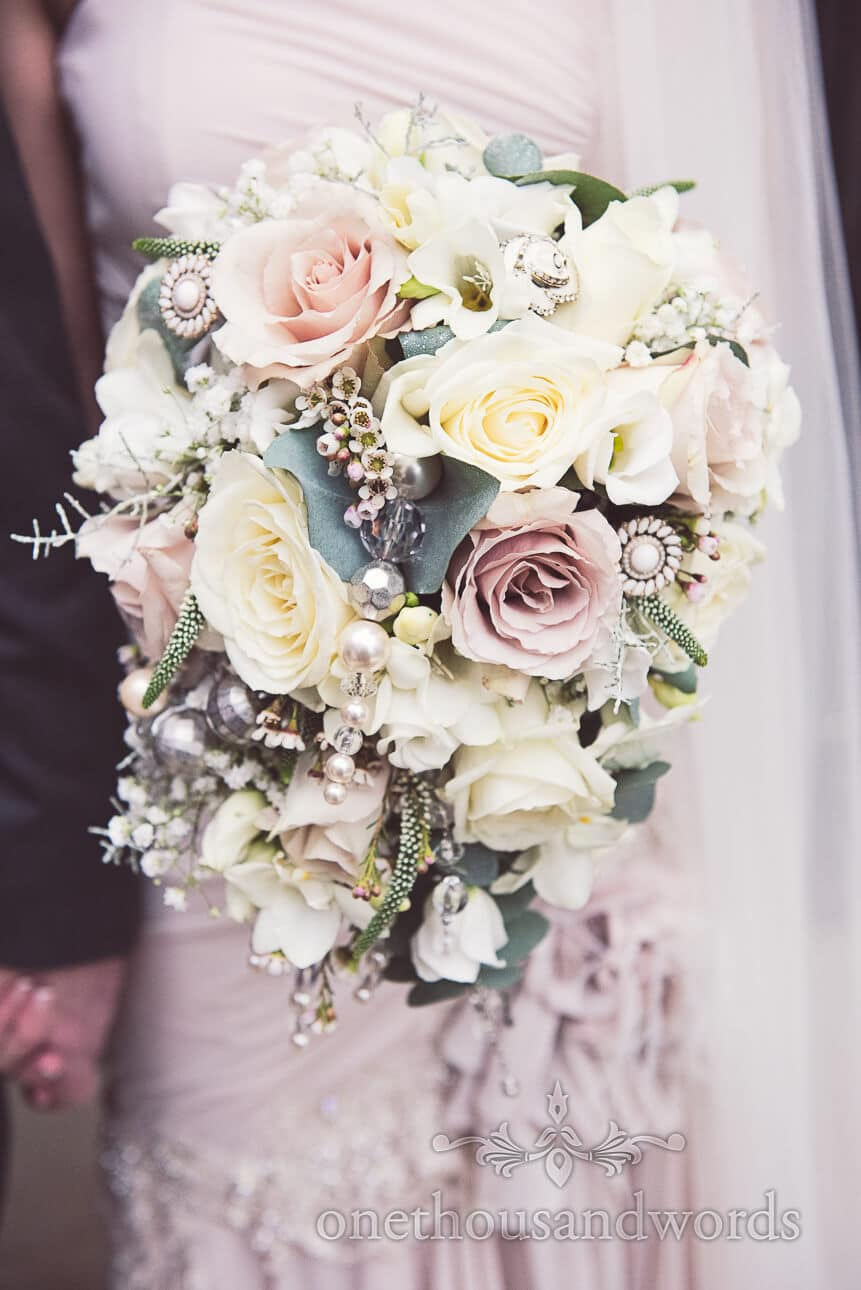 Stunning pastel roses decorated wedding bouquet