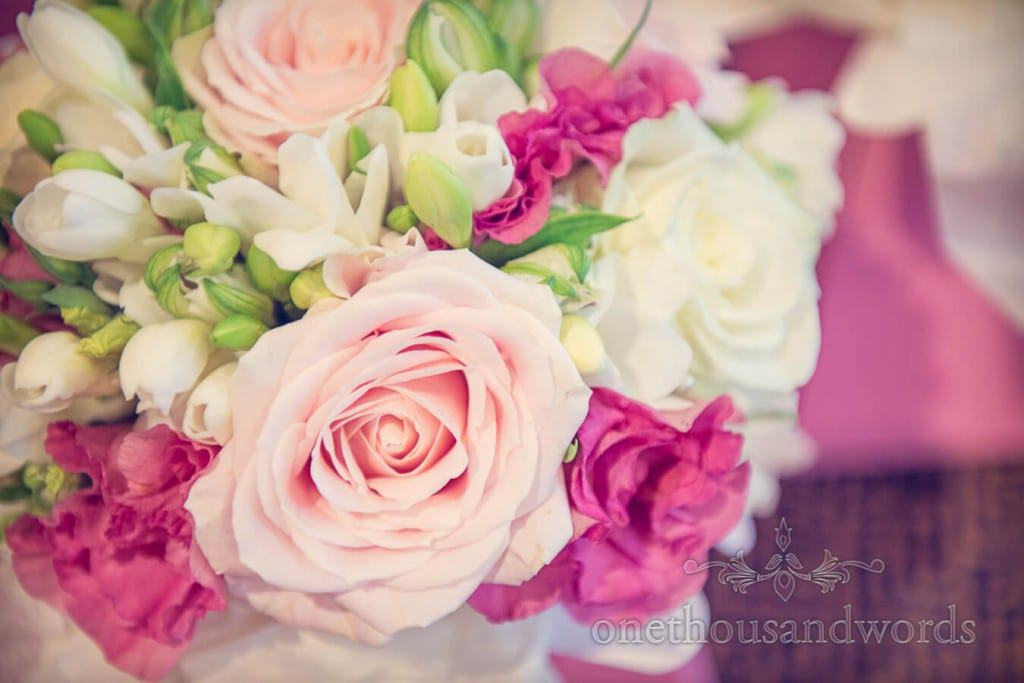 Different shades of pink and white wedding flowers bouquet