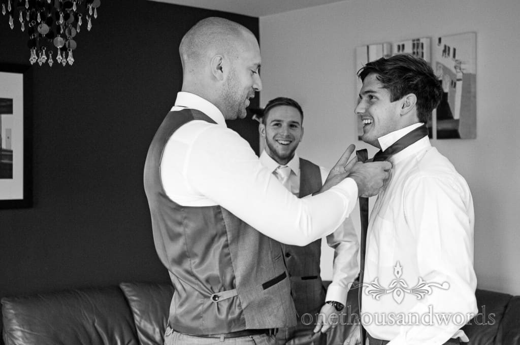 Black and white photograph of weddign morning groom preparations