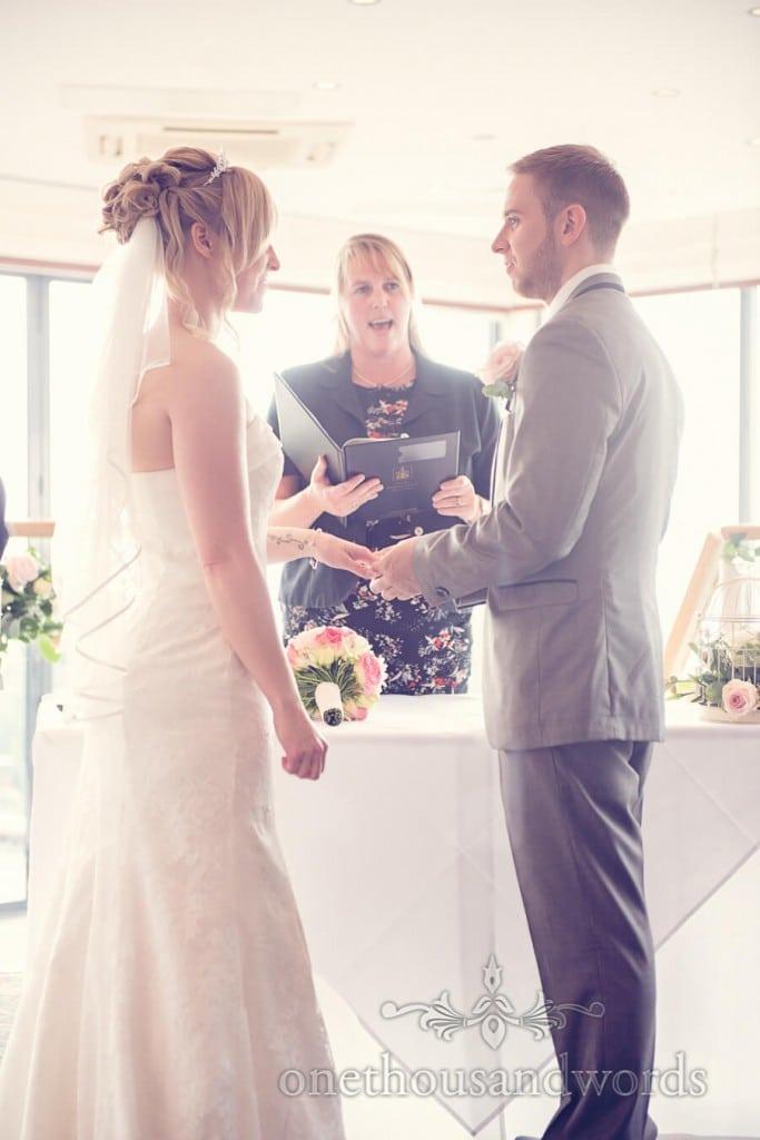 Bride and groom make wedding vows during hotel wedding ceremony