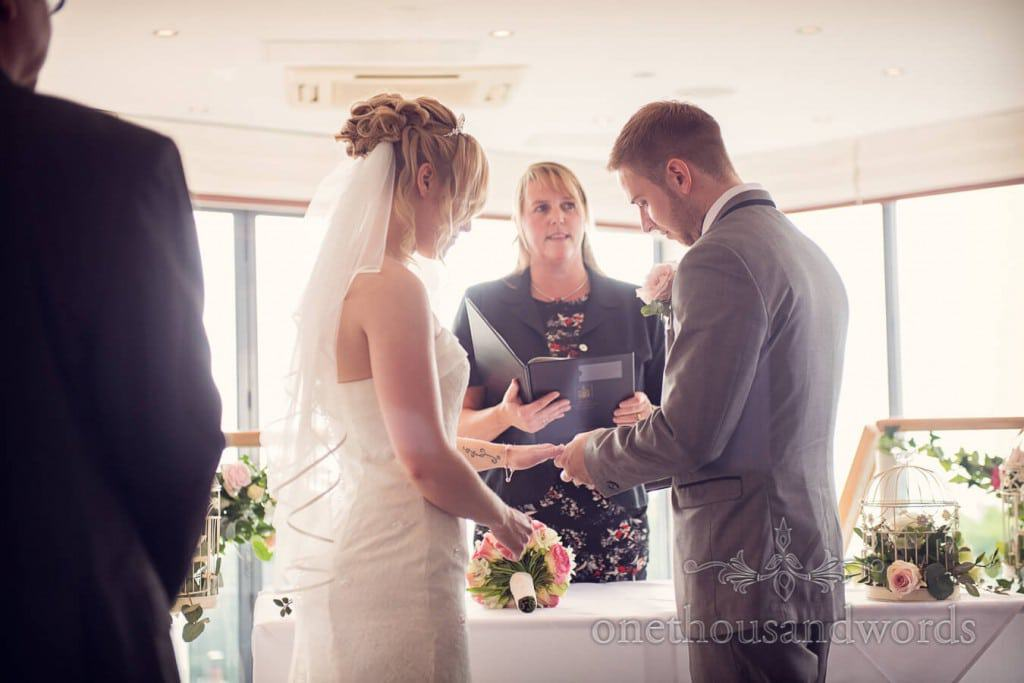 Exchange of rings during civil wedding ceremony at Dorset hotel
