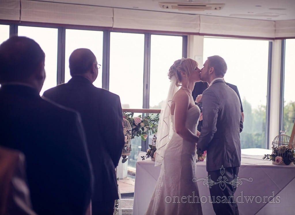 First kiss at hotel civil wedding ceremony photograph