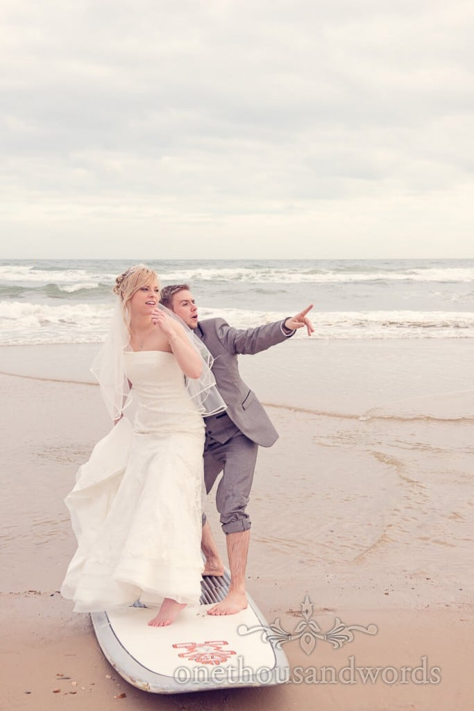 Bride and groom on surfboard at Harbour Heights Wedding Photograph