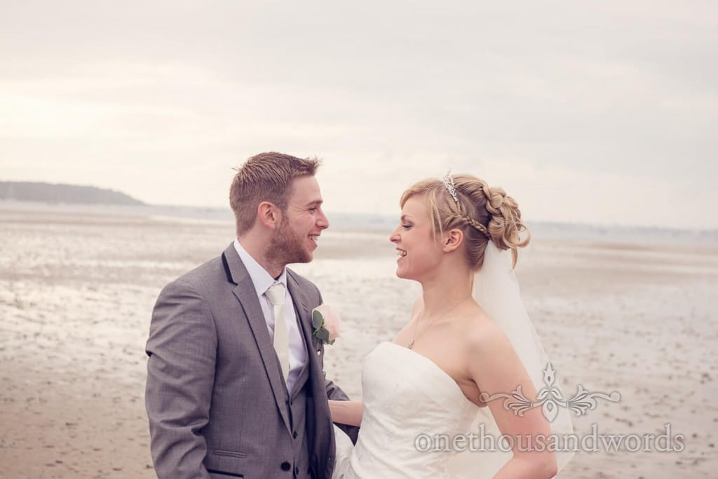 Bride and groom on beach at Harbour Heights wedding at Poole Harbour Dorset
